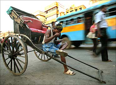 A rickshaw puller takes a break in Kolkata.