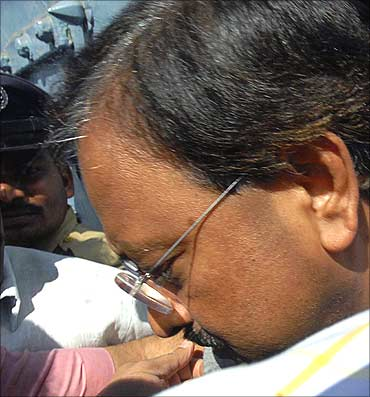 Ramalinga Raju is taken into police custody outside the Chanchalguda jail.