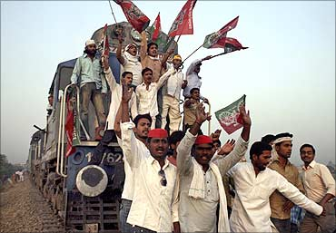 This file photo showsactivists of Samajwadi Party shout slogans after blocking a passenger train.