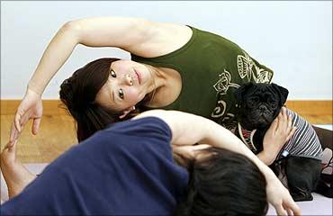 Instructor Momoe Yamamoto demonstrates yoga.