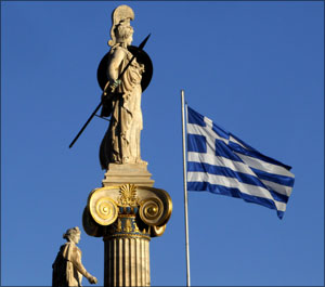 Image: A Greek national flag flutters in the air next to a statue of Athena in Athens. Photograph: Yiorgos Karahalis/Reuters