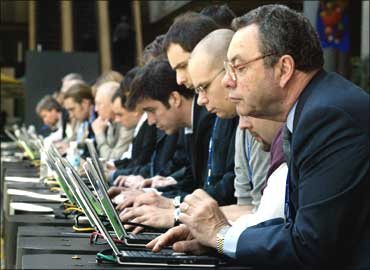 Attendees use wireless computers provided at a meeting in Georgia, Atlanta.