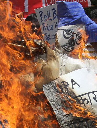 Protestors burn an effigy during a protest against the hike in fuel prices in New Delhi.