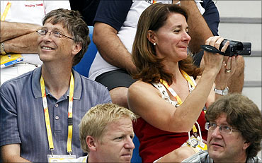 Microsoft chairman Bill Gates and wife Melinda watch the swimming finals during the Beijing Olympic Games.