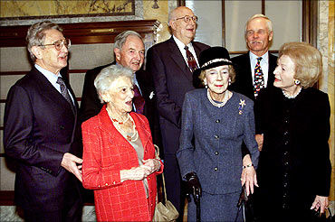 (L-R) George Soros, David Rockefeller Sr, William Gates Sr., Ted Turner, (front row L-R) Irene Diamond, Brooke Astor, and Leonore Annenberg.