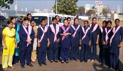 Revathi Roy (centre) with her staff.