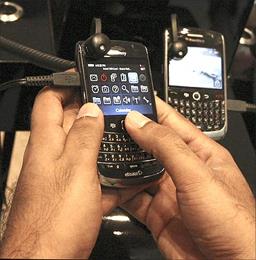 A man tests a BlackBerry phone at a shopping mall in Dubai.