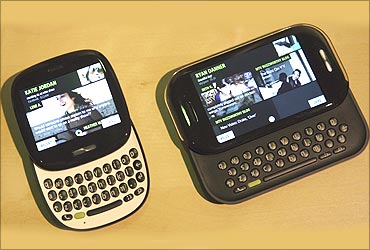 A pair of new smart phones called Kin One (L) and Kin Two are introduced at a Microsoft meeting.
