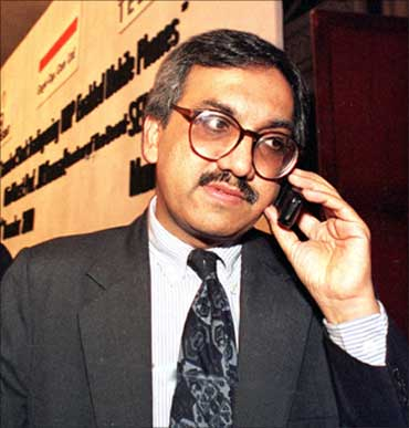 Ravi Narain chairman of the National Stock Exchange speaks on his mobile phone at a function to launch the first WAP-enabled share transaction in India, in Bombay on December 14, 2000.