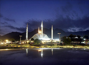 Clouds are pictured over the Faisal Mosque in Islamabad.