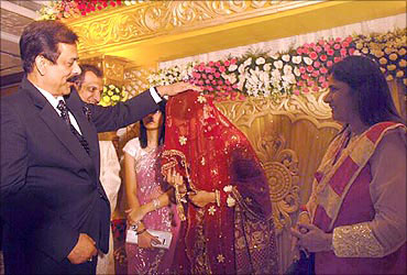 Sahara chairman Subroto Roy blesses India's tennis player Sania Mirza as parents look on.