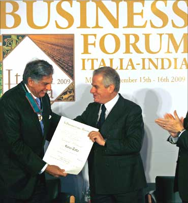 Italy's Economic Development Minister Claudio Scajola (R) confers the Order of Merit of Italian Republic award to Ratan Tata.