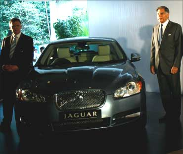 Tata Motors Chairman Ratan Tata (L) and David Smith, CEO of Jaguar Land Rover, pose with a Jaguar XF.