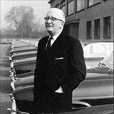 Sir William Lyons in front of the Jaguar factory.