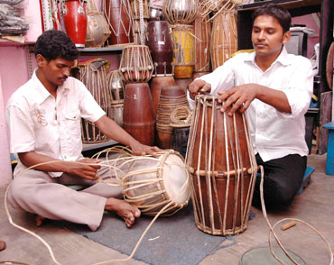 P Muthulingam repairing percussion instruments at his workshop.
