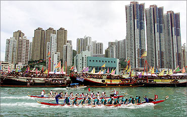 A dragon boat race at Hong Kong's Aberdeen fishing port.