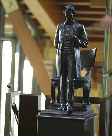 A statue of Abraham Lincoln stands just inside the entryway of the house.