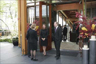 Washington Governor Chris Gregoire (2nd L) and her husband Mike Gregoire (L) talk to Melinda Gates (C) at the entrance of the house.