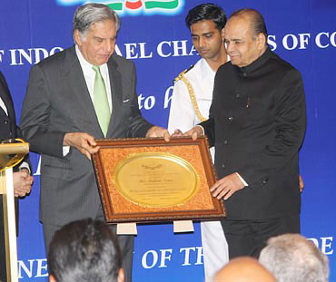 Tata being honoured as the Businessman of the Decade by Maharashtra Governor K Sankarnarayanan.