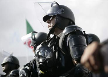 Police wearing anti-riot gear stand in formation near the venue of the climate talks in Cancun. Photograph: Gerardo Garcia/Reuters
