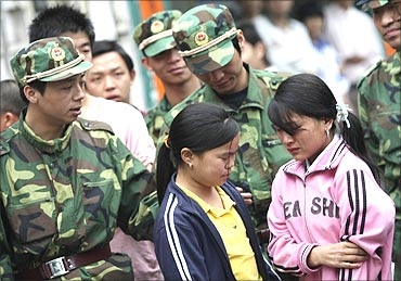 Two girls are rescued from a factory in Dongguan, Guangdong province, China.