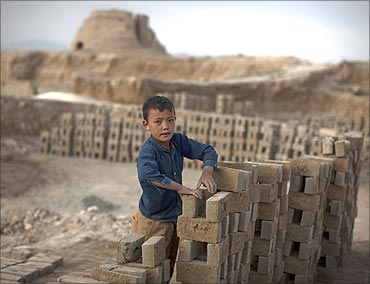 An Afghan boy works at a brick-making factory in Kabul.