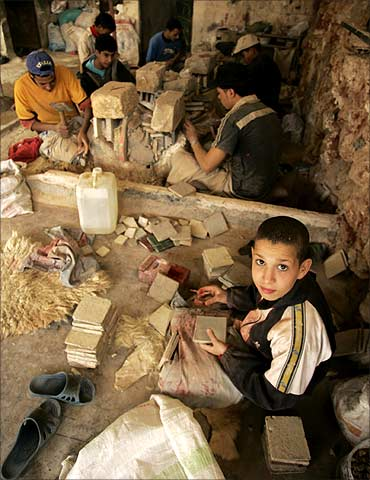 Children work at a stone workshop near Kenitra, Morocco.