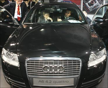 Microsoft founder Bill Gates checking out an Audi A6 4.2 Quattro.