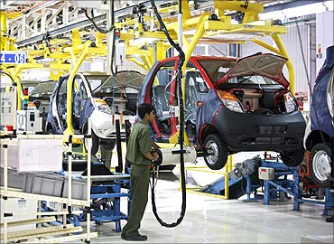 An employee works inside the newly inaugurated plant for the Tata Nano car at Sanand.