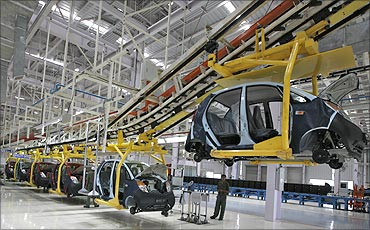 An employee stands inside the newly inaugurated plant for the Tata Nano.