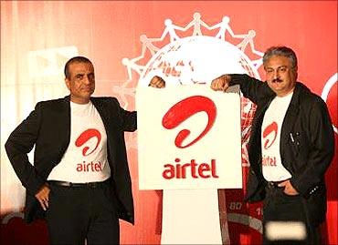 Sunil Mittal, chairman, Bharti Airtel and Sanjay Kapoor, CEO, Bharti Airtel (R).