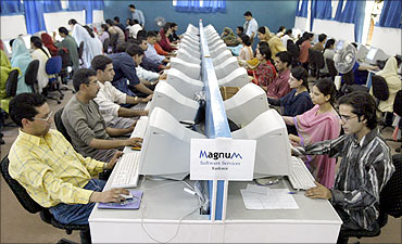 Kashmiris work at a business process outsourcing centre in Rangreth.