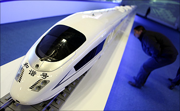 A visitor looks at a model of CRH (China Railway High-speed) Harmony bullet train.