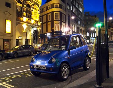 A Reva getting charged on a London street.