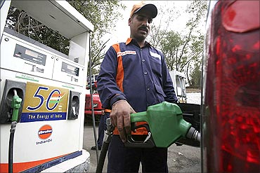 A worker at an Indian Oil petrol pump.