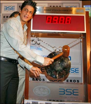 Bollywood actor Shah Rukh Khan poses before hitting the ceremonial gong during his visit to the BSE.