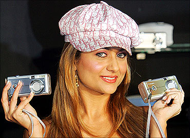 Bollywood actress Amrita Arora poses with Canon 'Powershot A400' digital cameras.