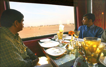 Guests sit inside the Swarna Mahal of the new luxury train, Royal Rajasthan on Wheels.