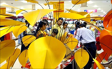 Shoppers check out products at a mall in the commercial hub of Noida in Uttar Pradesh.
