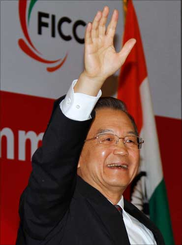 Chinese Premier Wen Jiabao waves as he attends the India-China Business Cooperation Summit in New Delhi on December 15, 2010.