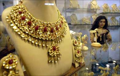 A visitor tries on jewellery.