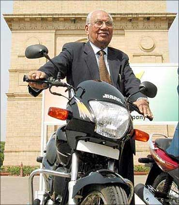 Brijmohan Lall (L), Chairman of India's top motorcycle maker, Hero Honda Motors Ltd.