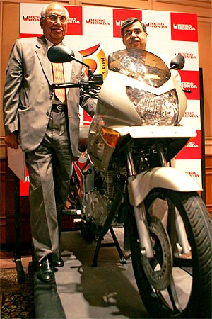 Brijmohan Lall (L), Chairman of India's top motorcycle maker, Hero Honda Motors Ltd. and Managing Director Pawan Kant Munjal