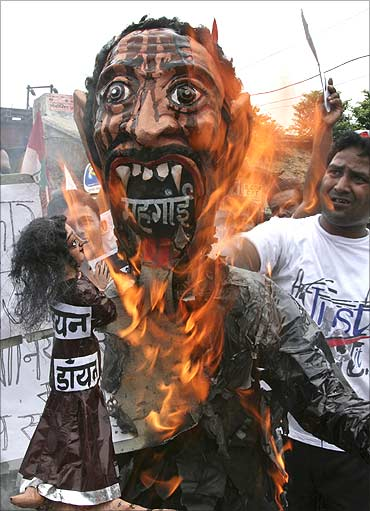 Activists of Samajwadi Party burn an effigy of Inflation.