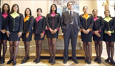 Jeh Wadia, Managing Director of GoAir with flight attendants.