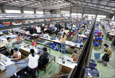 Factory workers assemble garments to be exported abroad on the outskirts of the Laotian capital Vientiane.