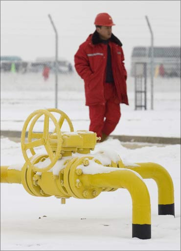 A worker walks past gas taps of the Kazakh stretch of the new 1,833-kilometre Turkmenistan-China pipeline at Otar gas station, near Almaty.
