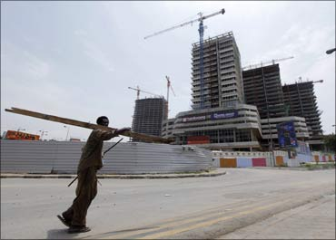 An Angolan man walks past office blocks under construction in the capital Luanda.