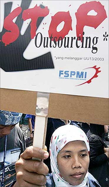 A woman protesting against outsourcing at a rally in front of Japan's embassy in Jakarta.
