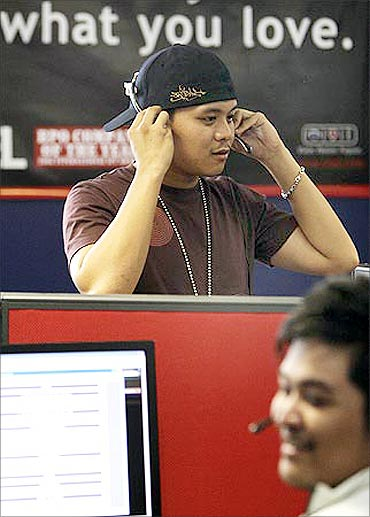 Sitel employees take calls from international customers at its new facility in Pasig City.